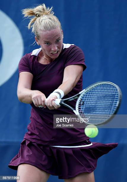 Richel Hogenkamp of the Netherlands returns a shot to Heather Watson of the United Kingdom during her first round Women's Singles match on Day Two of...