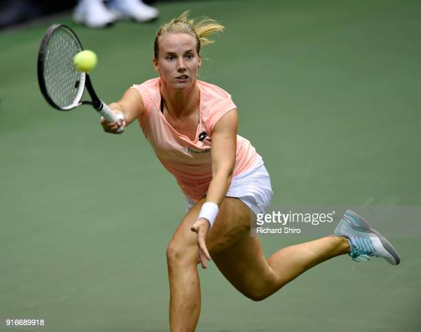 Richel Hogenkamp of the Netherlands returns a volley by Coco Vandeweghe of Team USA during the first round of the 2018 Fed Cup at US Cellular Center...