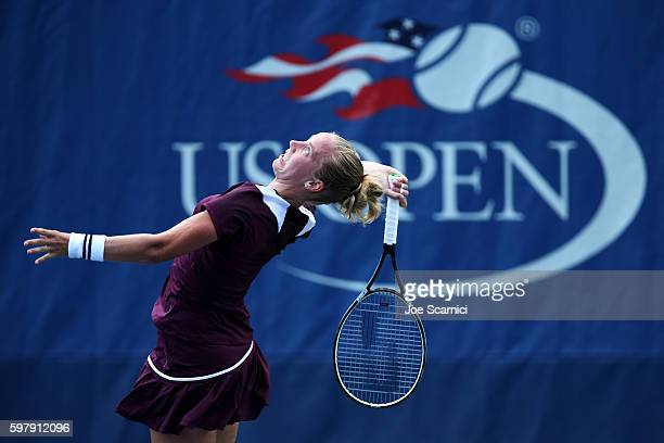 Richel Hogenkamp of the Netherlands serves to Heather Watson of the United Kingdom during her first round Women's Singles match on Day Two of the...