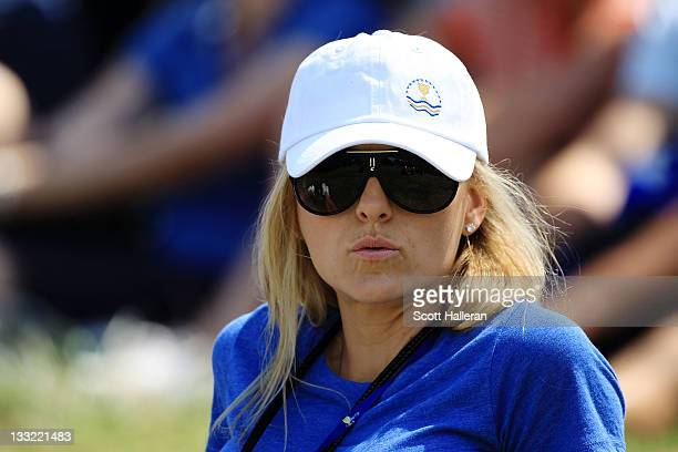 Richelle Baddeley wife of Aaron Baddeley of the International Team watches play during the Day Two FourBall Matches of the 2011 Presidents Cup at...