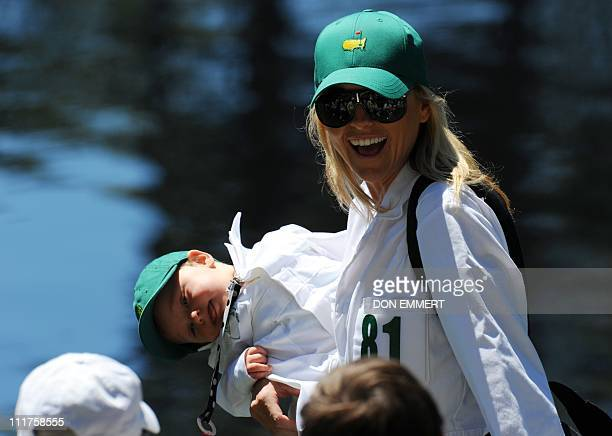 Richelle Baddeley wife of Australian golfer Aaron Baddeleywalks with her daughter Jolee during the Par 3 Contest prior to the 2011 Masters Tournament...