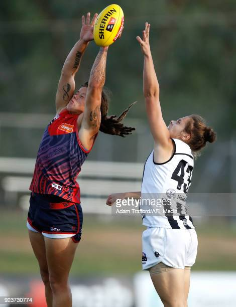 Richelle Cranston of the Demons and Jasmine Garner of the Magpies compete for the ball during the 2018 AFLW Round 04 match between the Melbourne...