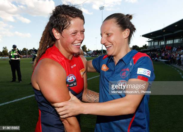 Richelle Cranston of the Demons and Karen Paxman of the Demons celebrate during the 2018 AFLW Round 01 match between the Melbourne Demons and the GWS...