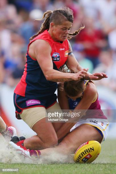 Richelle Cranston of the Demons crunches Jamie Stanton of the Lions during the round one Women's AFL match between the Melbourne Demons and the...