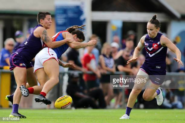 Richelle Cranston of the Demons is tackled by Evangeline Gooch of the Dockers during the round three AFLW match between the Fremantle Dockers and the...