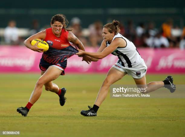 Richelle Cranston of the Demons is tackled by Jasmine Garner of the Magpies during the 2018 AFLW Round 04 match between the Melbourne Demons and the...