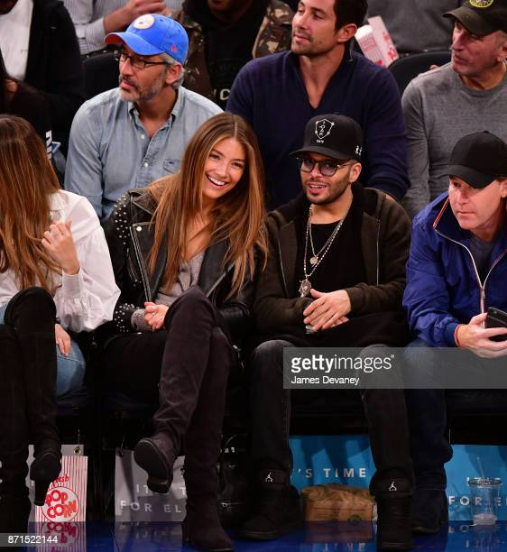Richie Akiva and guest attend the Charlotte Hornets Vs New York Knicks game at Madison Square Garden on November 7 2017 in New York City
