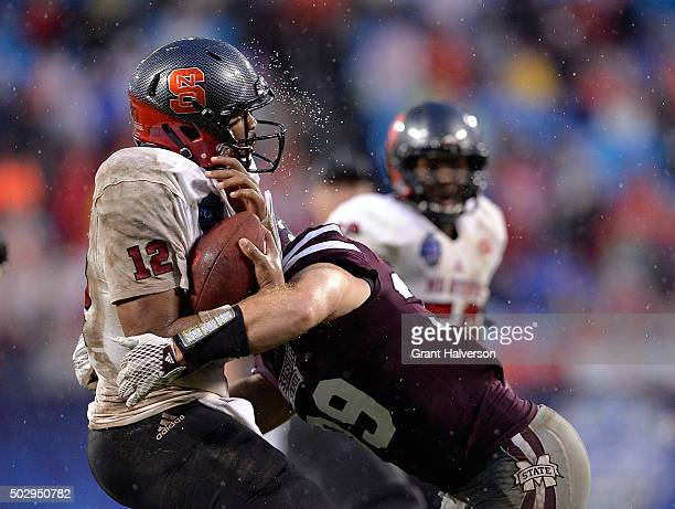 Richie Brown of the Mississippi State Bulldogs sacks Jacoby Brissett of the North Carolina State Wolfpack during the Belk Bowl at Bank of America...
