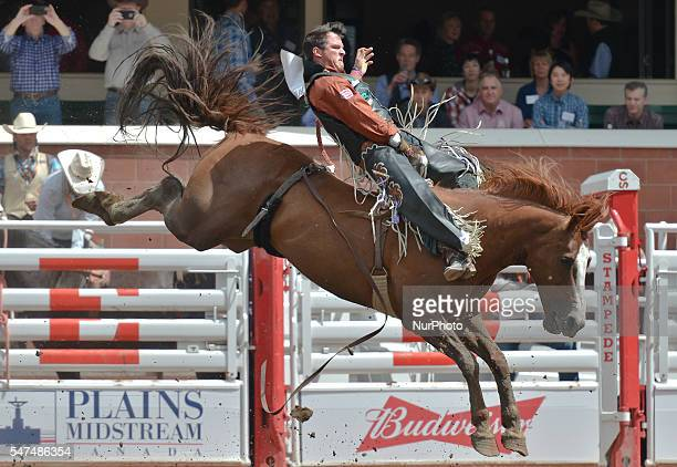 Richie Champion from Dublin TX on Jenny's Red Wine in action during Bareback competition at the Calgary Stampede 2016 Twenty of the world's top...