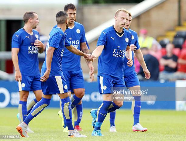 Richie De Laet of Leicester City congratulates goal scores Riyad Marez of Leicester City after he scores to make it 11 during the preseason friendly...