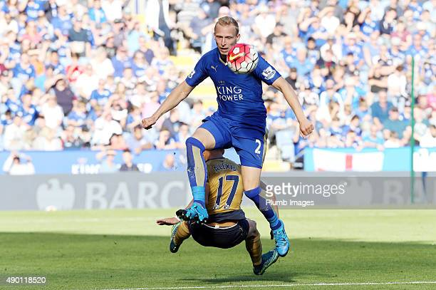 Richie De Laet of Leicester City in action with Alexis Sanchez of Arsenal during the Barclays Premier League match between Leicester City and Arsenal...