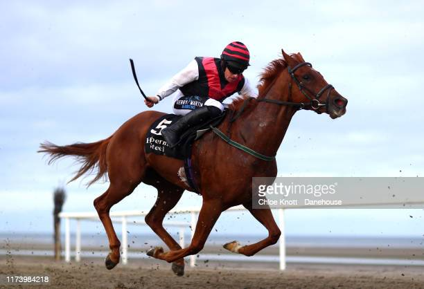 Richie Deegan riding Barbie Conor takes part in The Hibernia Steel QR race at the Laytown races on on September 11 2019 in Laytown Ireland