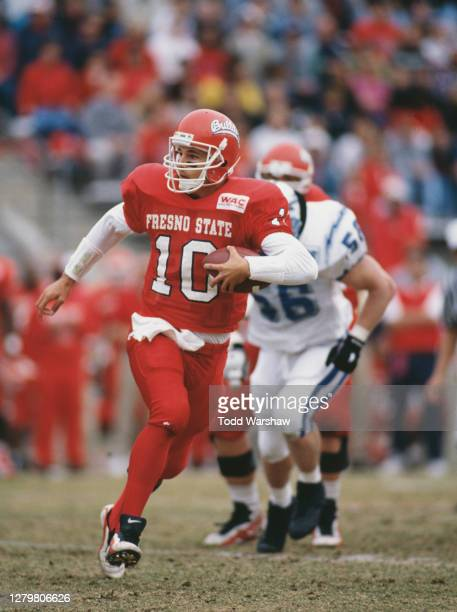 Richie Donati, Quarterback for the Fresno State Bulldogs runs the football upfield during the NCAA Western Athletic Conference college football game...
