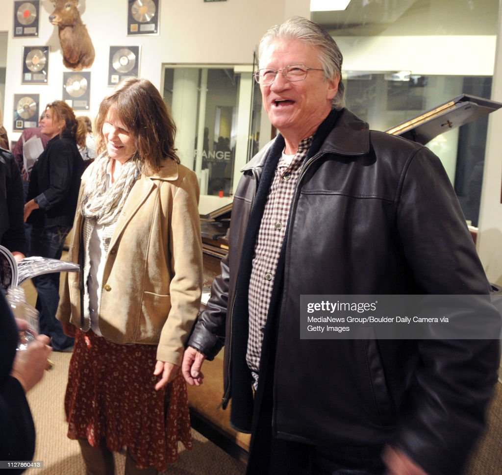 Richie Furay, right, and his wife, Nancy, talks to people at