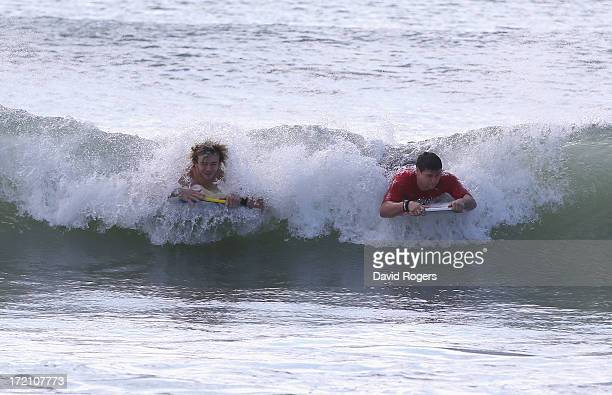 Richie Gray and Ben Youngs of the British and Irish Lions ride a wave as they take part in surfing on July 2 2013 in Noosa Australia