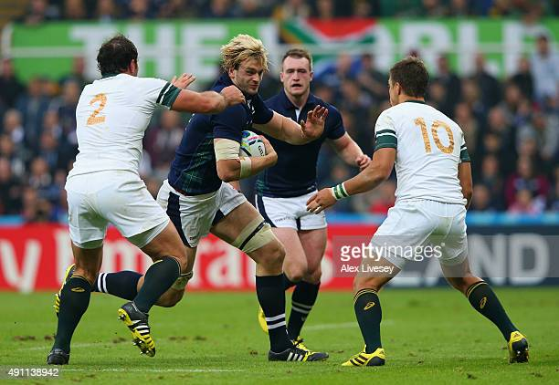 Richie Gray of Scotland hands off Bismarck Du Plessis of South Africa and Handre Pollard of South Africa during the 2015 Rugby World Cup Pool B match...