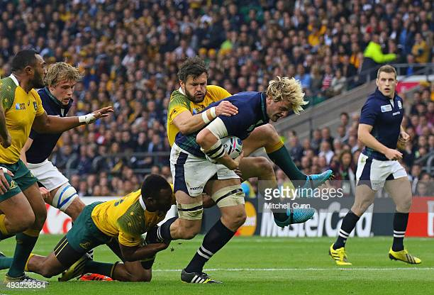 Richie Gray of Scotland is tackled by Adam AshleyCooper of Australia during the 2015 Rugby World Cup QuarterFinal match between Australia and...