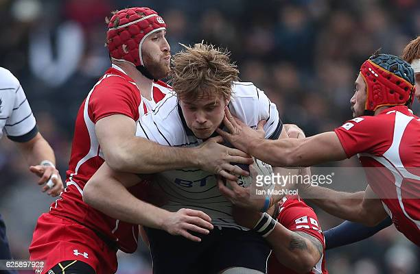 Richie Gray of Scotland is tackled by Beka Bitsadze of Georgia during the Autumn Test Match between Scotland and Georgia at Rugby Park on November 26...