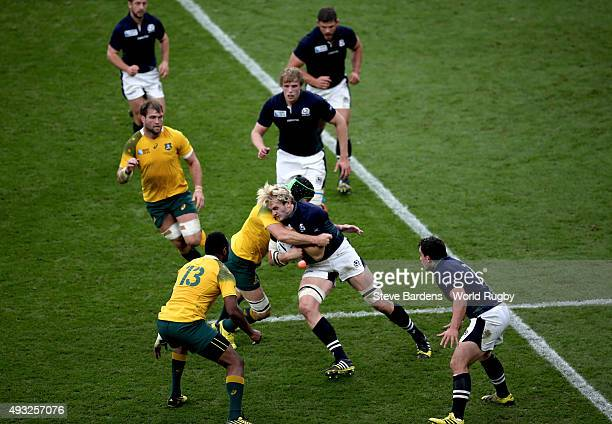 Richie Gray of Scotland is tackled by Kane Douglas of Australia during the 2015 Rugby World Cup Quarter Final match between Australia and Scotland at...