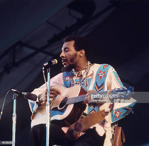 Richie Havens performs on stage at the Isle of Wight Festival on August 31 1969