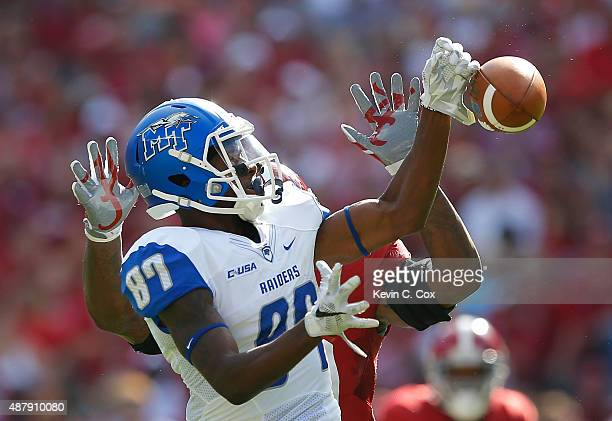 Richie James of the Middle Tennessee Blue Raiders fails to pull in this reception against Reuben Foster of the Alabama Crimson Tide at Bryant-Denny...