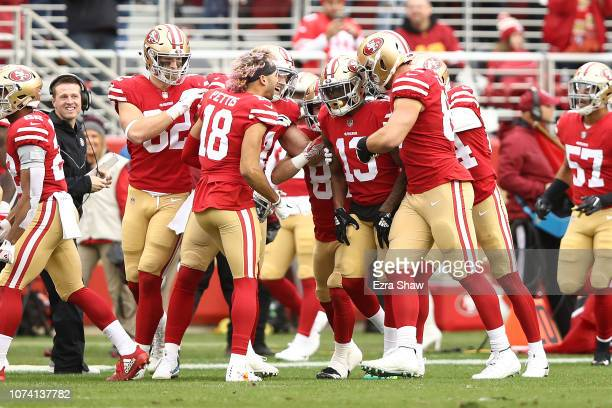 Richie James of the San Francisco 49ers celebrates after returning a kickoff for a touchdown against the Seattle Seahawks during their NFL game at...