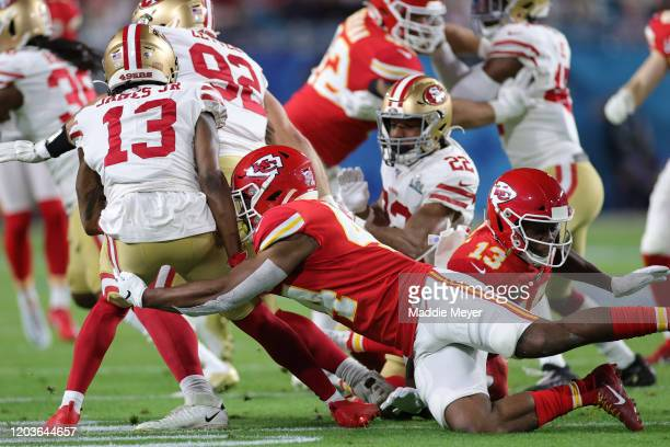 Richie James of the San Francisco 49ers is tackled by Dorian O'Daniel of the Kansas City Chiefs in the second quarter in Super Bowl LIV at Hard Rock...