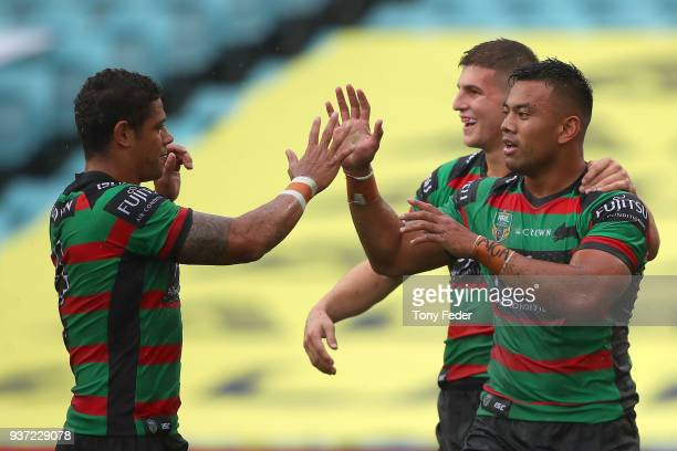 Richie Kennar of the Rabbitohs celebrates a try with team mates during the round three NRL match between the South Sydney Rabbitohs and the Manly Sea...