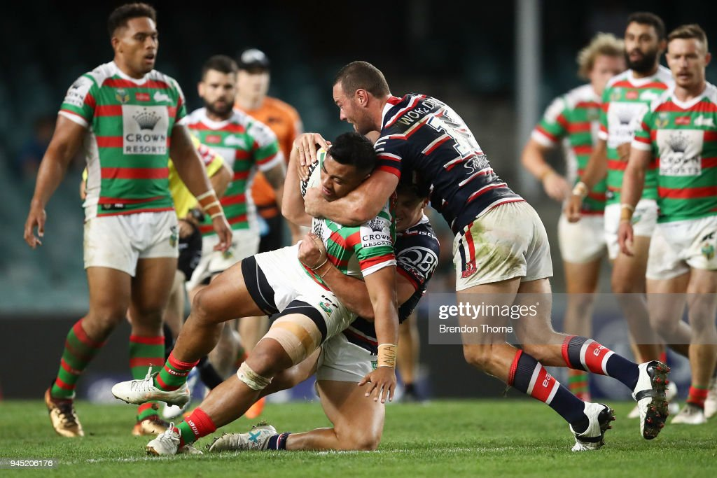 Richie Kennar of the Rabbitohs is tackled by Roosters defence during the round six NRL match between the Sydney Roosters and the South Sydney Rabbitohs at Allianz Stadium on April 12, 2018 in Sydney, Australia.