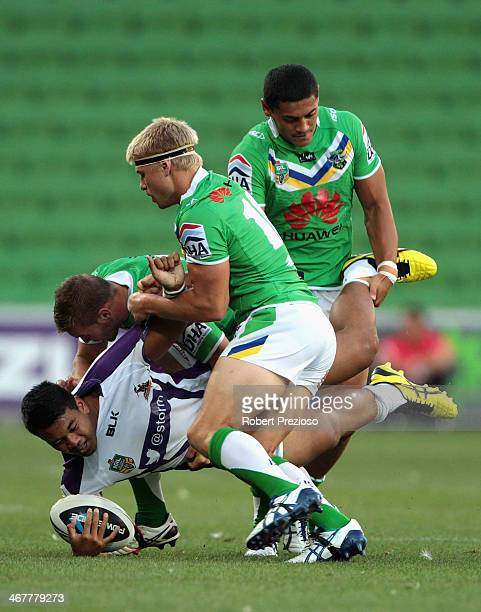 Richie Kennar of the Storm is tackled during the NRL trial match between the Melbourne Storm and the Canberra Raiders at AAMI Park on February 8,...