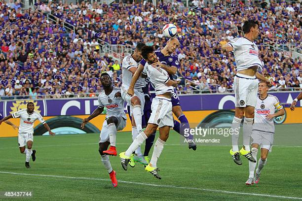 Richie Marquez of Philadelphia Union fights for the ball against Aurelien Collin of Orlando City SC during a MLS soccer match between the...