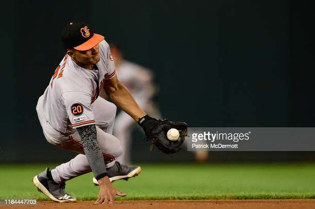 Richie Martin of the Baltimore Orioles fields a ground ball and throws out Yan Gomes of the Washington Nationals at first base in the fifth inning...