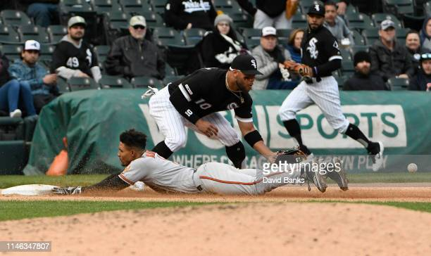 Richie Martin of the Baltimore Orioles is safe at third base with a triple as Yoan Moncada of the Chicago White Sox makes a late tag during the...