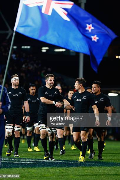 Richie McCaw and Dan Carter of the All Blacks shake hands before The Rugby Championship match between the New Zealand All Blacks and Argentina at AMI...