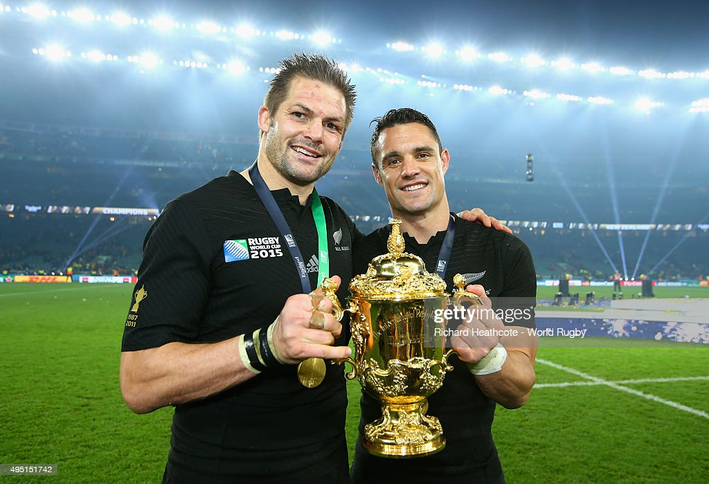 Richie McCaw and Dan Carter of the New Zealand All Blacks poses with the Webb Ellis Cup following the victory against Australia in the 2015 Rugby World Cup Final match between New Zealand and Australia at Twickenham Stadium on October 31, 2015 in London, United Kingdom.