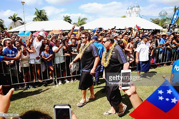 Richie McCaw and head coach Steve Hansen of the New Zealand All Blacks are welcomed by fans following a parade through the main streets of Apia on...