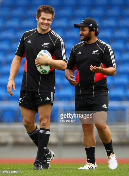 Richie McCaw and Piri Weepu of the All Blacks chat during a New Zealand All Blacks captain's run at Trusts Stadium on October 22, 2011 in Auckland,...