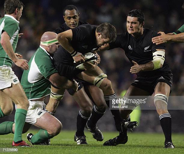 Richie McCaw Captain of the All Blacks is tackled by John Hayes of Ireland as Joe Rokocoko and Troy Flavell of the All Blacks back up and Rodney...