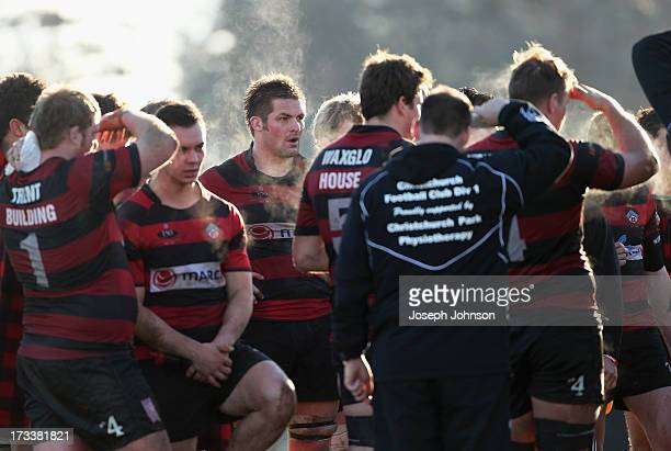Richie McCaw of Christchurch with his team mates at half time during the Christchurch Club Rugby match between Christchurch and University on July 13...