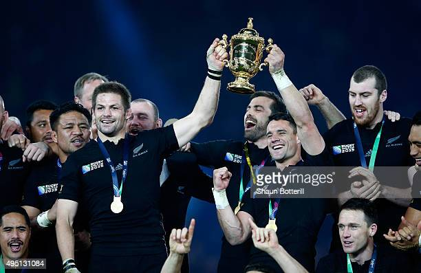 Richie McCaw of New Zealand and Dan Carter of New Zealand hold aloft the Webb Ellis Cup after victory in the 2015 Rugby World Cup Final match between...