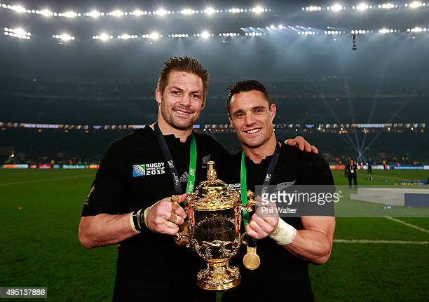 Richie McCaw of New Zealand and Dan Carter of New Zealand pose with the Webb Ellis Cup after victory in the 2015 Rugby World Cup Final match between...