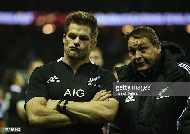 Richie McCaw of New Zealand and Steve Hansen head coach of New Zealand lookm on after defeat during the QBE International match between England and...