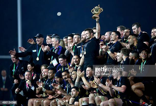 Richie McCaw of New Zealand holds aloft the Webb Ellis Cup as New Zealand celebrate winning the 2015 Rugby World Cup Final match between New Zealand...