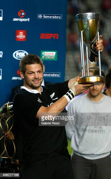 Richie McCaw of New Zealand holds the champions trophy after a match between Argentina Los Pumas and New Zealand All Blacks as part of fifth round of...