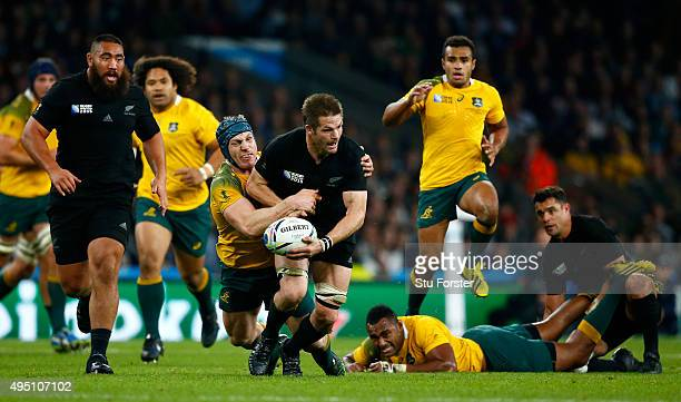 Richie McCaw of New Zealand is tackled by David Pocock of Australia during the 2015 Rugby World Cup Final match between New Zealand and Australia at...