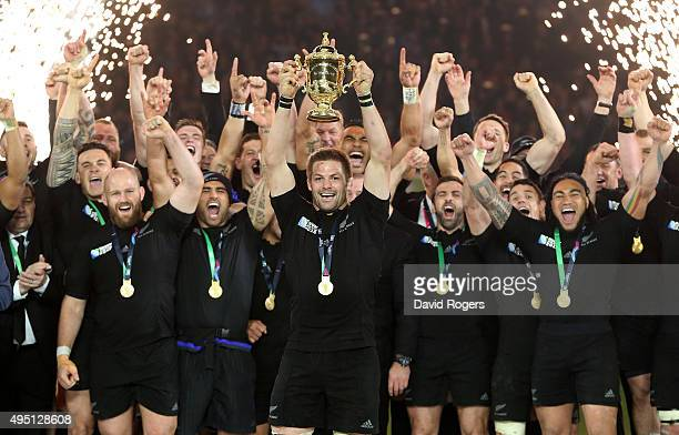 Richie McCaw of New Zealand lifts the trophy after victory during the 2015 Rugby World Cup Final match between New Zealand and Australia at...
