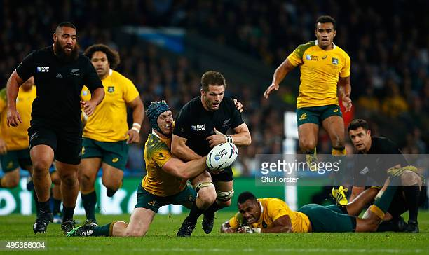 Richie McCaw of New Zealand loses the ball as he is tackled by David Pocock of Australia during the 2015 Rugby World Cup Final match between New...