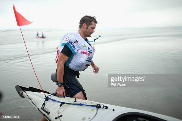 Richie McCaw of Team Cure Kids pulls his kayak onto the beach on Rabbit Island on day one of the GODZone multi day adventure race on April 2 2016 in...
