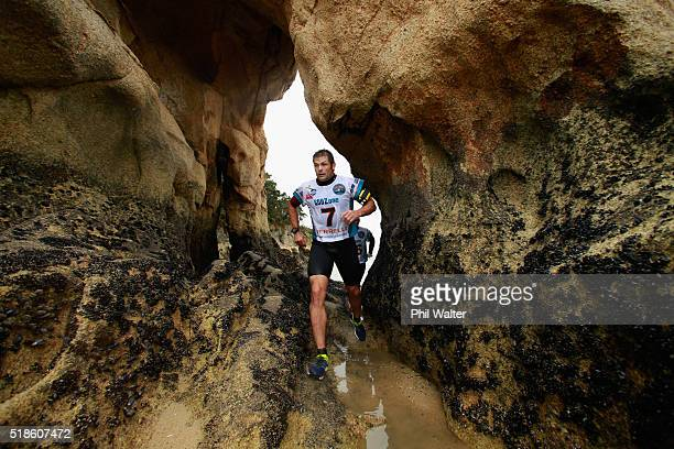 Richie McCaw of Team Cure Kids runs along the Kaiteriteri coastline during the GODZone multi day adventure race on April 2 2016 in Nelson New Zealand