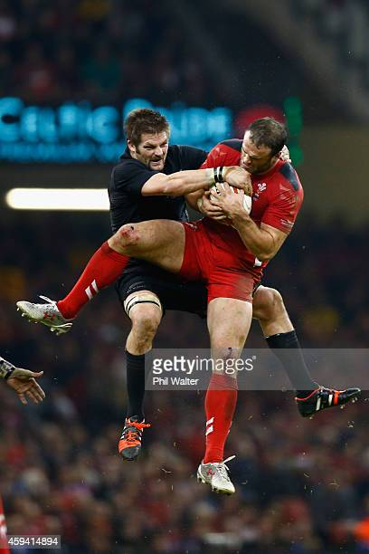 Richie McCaw of the All Blacks and Jamie Roberts of Wales contest the high ball during the Intenational match between Wales and the New Zealand All...